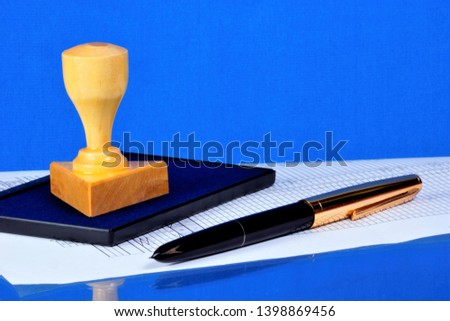 Stamp and pen - authentication of documents. Stamp — relief device for obtaining the same graphic prints of the name of administrative, legal, commercial purpose.