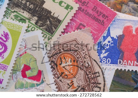 Stamp collage from different countries.   A variety of stamps in different colors and sizes from different countries