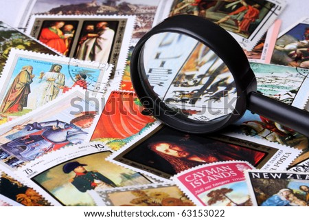 Stamp collection with magnifying glass, shallow depth of field