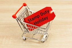 Stamp Duty Holiday Concept - with message in a shopping trolley