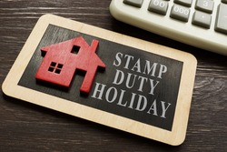 Stamp duty land tax holiday and model of house.