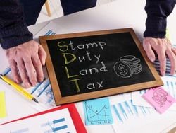 Stamp Duty Land Tax SDLT is shown on the conceptual photo using the text