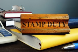 Stamp duty sign and office supply with business papers.