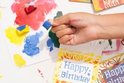 Stamping bag with stencils and sponge impregnated in paint. Making gifts to celebrate the birthday.