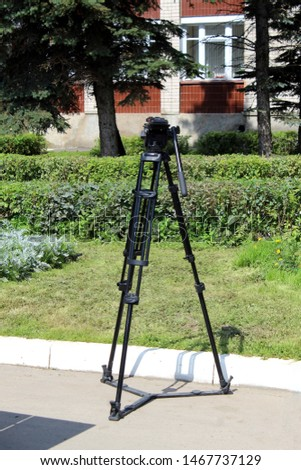 Stand for a tripod for a studio strobe and lighting fixtures. Professional equipment for photographers.