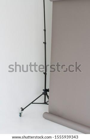 Stand for background. Photo studio equipment. Studio paper background
