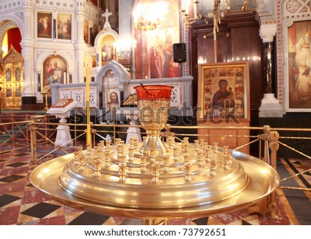 Stand for candles near Altar inside Cathedral of Christ the Saviour in Moscow, Russia