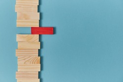 Stand out from crowd mockup. Not like everyone. White crow. Uniqueness and originality. Wooden planks with red block