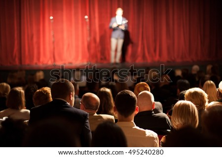 stand up comedian on stage Stockfoto ©