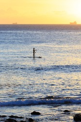Stand Up Paddling in the Ocean during Sunset