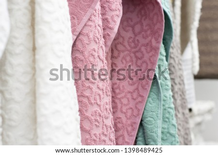 Stand wih towels in a shop. Soft focus. #1398489425