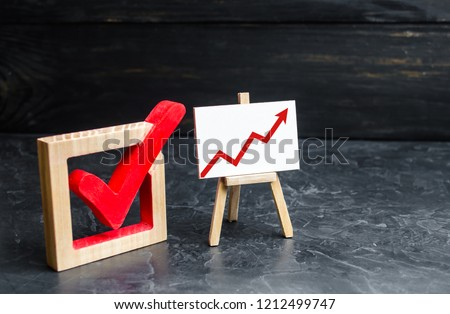 Stand with a red up arrow and a check mark. The concept of high voter turnout, the growth of statistical indicators. Voting, high rating. Raising the popularity of politicians parties selective focus