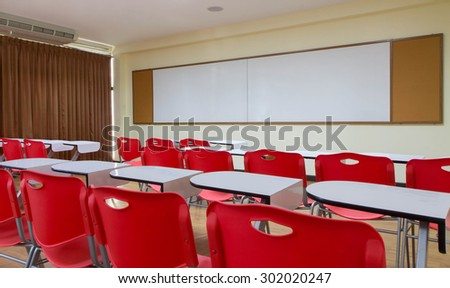 standard classroom interior with red chair