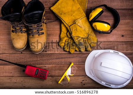 Standard construction safety equipment on wood background #516896278