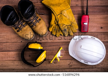 Standard construction safety equipment on wood background #516896296