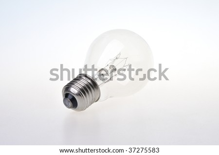 Standard light bulb lying on white background