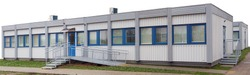 Standard modules made of metal and wood are used for the  construction of hospitals and schools. Panoramic collage