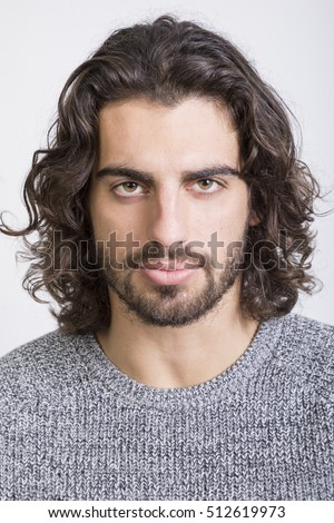 Standard portrait of young man with long hair.