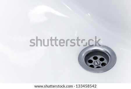 Standard round drain hole in white domestic sink