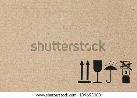 Standard signs on a flat brown cardboard box with copy space