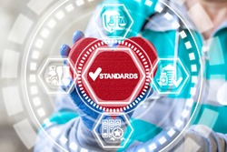 Standards Quality Medicine concept. Doctor holding red heart and standards check mark icon on virtual interface. Healthcare Control Regulation.