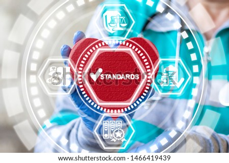 Standards Quality Medicine concept. Doctor holding red heart and standards check mark icon on virtual interface. Healthcare Control Regulation. ストックフォト ©