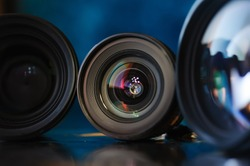 Standart camera lens with aperture inside, colorful reflection.