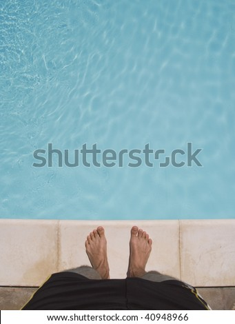 standing at the edge of a swimming pool. about to jump in. great for copy-text.