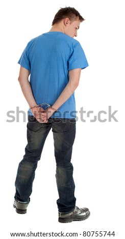 standing back young man with handcuffed hands