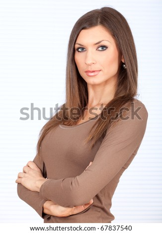standing beautiful woman with crossed arms