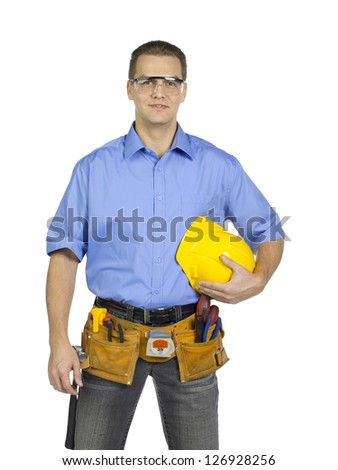 Standing construction worker holding a hard hat Photo stock ©