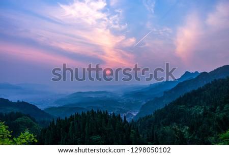 Standing in chongshan overlooking the sunrise of zhangjiajie city #1298050102