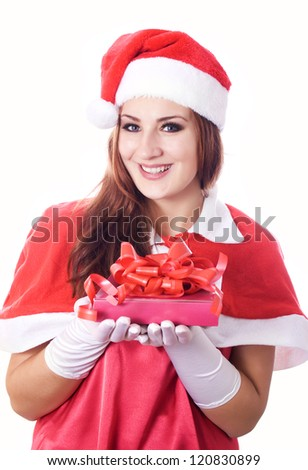 Standing indoors and holding christmas gift