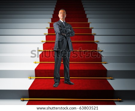 standing japanese businessman on red carpet stair