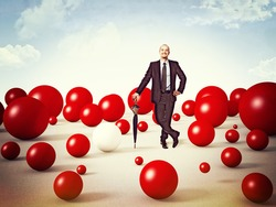 standing man and lots of red sphere
