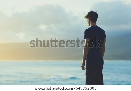 Standing Man watching the ocean view Sunrise. #649752805