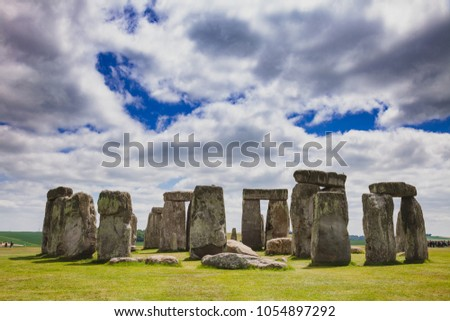 Standing megalith stones of ancient prehistoric monument Stonehenge in Wiltshire, South West England, UK, UNESCO World Heritage Site - Shutterstock ID 1054897292