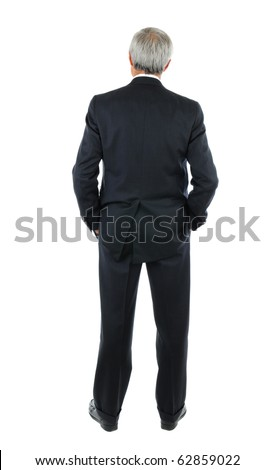 Standing middle aged businessman with both hands in his pockets. Business man is in full  length shot of the mans back over a white background.