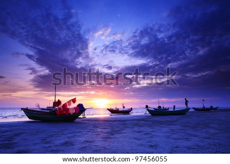 Standing on a fishing boat at sunset in eastern Thailand