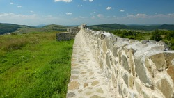 Standing on the ruins of a roman stone wall. The defensive fortification can be found in Zalau, Romania - the old Dacia province. Porolissum castrum guarded the northern borders of the Roman Empire.
