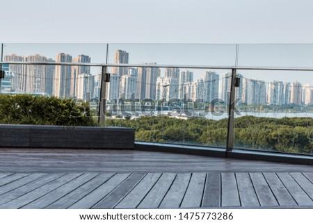 Standing on the skyscraper roof overlooking the skyline of Jinji Lake City, Suzhou City, Jiangsu Province, China #1475773286