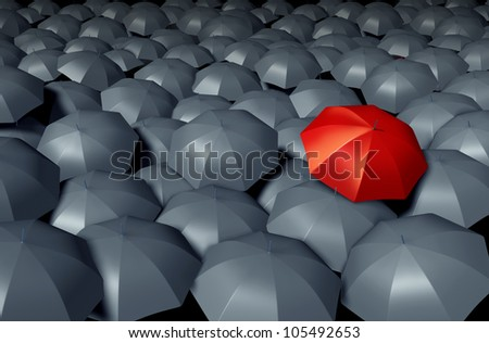 Standing Out From The Crowd with a red umbrella against a group of gray umbrellas as a storm weather business concept of unique and different protection and security.