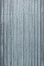 Standing photo of vertical gray-blue wooden planks at a cattle barn in the Netherlands