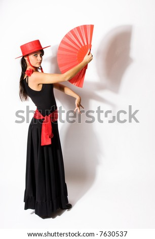 Standing pose of a Spanish flamenco dancer with fan