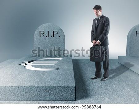 standing sad man and euro tomb