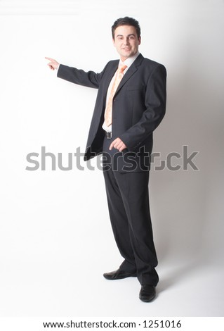 standing white businessman in suit pointing at chart