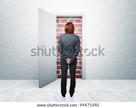 standing woman and closed door