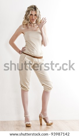 standing woman wearing summer clothes and shoes