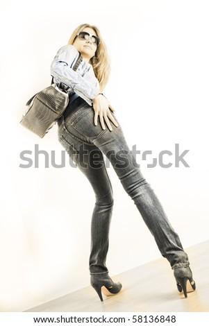 standing woman with handbag
