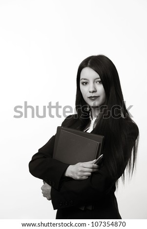 standing young business woman holding documents